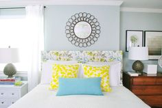 This headboard makes me want to have an upholstered headboard, because it isn't a velvet tufted style!  But a simple fun fabric--that's my style.  Young House Love