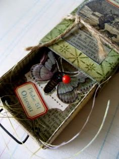 Ephemera. Bug in a box. The papers are from 7 Gypsies, the Conservatory range. Not a tin, but cute.