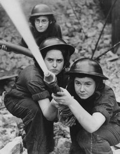 1941, Training at the UK's Royal Northern Hospital in Holloway practice for blitz fires. | 25 Stunning Vintage Photographs Of Female Firefighters
