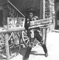 Cameron Mitchell (Buck Cannon) with High Chaparral merchandise. Cameron Mitchell Actor, The High Chaparral, Cannon, Rebel, Behind The Scenes, Crystal, Actors, Tv, Celebrities