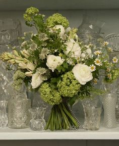 This beautiful old-fashioned looking bouquet entitled ''Meadowy Whites' comes from Scarlet & Violet