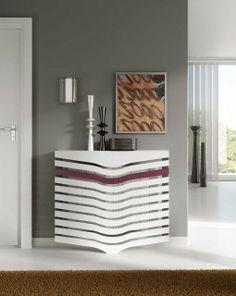 Cubreradiador moderno Hybrida Cubreradiador moderno que destaca por sus formas fluidas, de estilo orgánico depurado. Una pieza singular, que se adapta perfectamente a las casas más modernas.