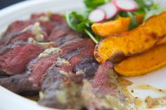 Marinated Sous Vide Grassfed Bison Tri-Tip, accompanied by an Organic Arugula Salad and Balsamic Vinaigrette and Roasted Sweet Potatoes.