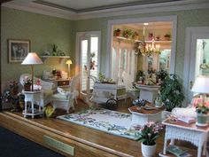 Miniature sun room - I love the shelves above the french doors!.