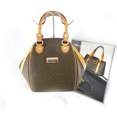 "Bag ""Ted Lapidus"" brown. $225.0"