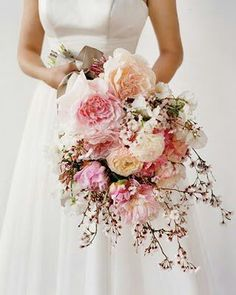 Classic over the arm. Replace peonies with roses and the cherry blossoms with baby's breath!