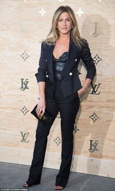 All-black ensemble: Jennifer took the plunge in a low-cut leather bustier, covering up with a smart blazer