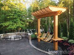 "A petite pergola with a swing for two creates the perfect ""night out."" Landscaping, hardscapes and pergola: Townescapes; Backyard Hammock, Pergola Swing, Outdoor Pergola, Backyard Patio, Backyard Landscaping, Small Pergola, Modern Pergola, Wisteria Pergola, Pergola Lighting"