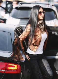 Tan leather jacket, white tee, scarf, black pants...