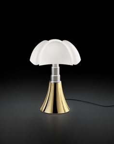 Pipistrello, The anniversary edition|Martinelli Luce has produced an exclusive version in Gold finish, presented in Paris for the first time at the Italian Institute of Culture http://pipistrello.martinelliluce.com/