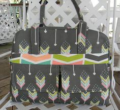 Gray Diaper Bag Pink Arrows with lots of pockets.