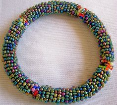 Maasai African Beaded Bangles- Bracelet 2 to 3 Inches Diameter Different  Shades of Maasai Beads by Africanheritagegifts on Etsy https://www.etsy.com/listing/182645907/maasai-african-beaded-bangles-bracelet-2