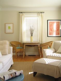 Pair shadings with drapes to add a bright touch to a neutral, cottage-style living room