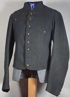 Of the few variegated Confederate jackets that do survive, still fewer can be positively linked to a specific depot.  However, thanks to Les Jenson's extensive research, the different patterns made at the Richmond Depot can be identified by their cut and the materials used in their construction.  This is the only known Regulation Third Depot with contemporaneous regulation blue infantry piping on the sleeves.