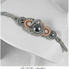The soutache bracelet The Grey Intrigue - made of hematites, Swarovski rivoli and Swarovski beads. The length of the bracelet shall be customized individually.  Bransoletka sutasz The Grey Intrigue - wykonana z hematytów, kryształków Swarovski'ego i pereł Swarovski'ego. Długość bransoletki dopasowana indywidualnie.  Available in my shop at Etsy: http://www.etsy.com/uk/shop/eMKaHandMade (also more photos)  #soutache  #uniquedesign #etsysellersofinstagram #forwoman #occasion #bijoux #schmuck…