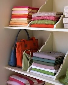 Keep stacks of shirts, folded linens, and other closet items from toppling into disarray by installing wooden shelf brackets as dividers. @ DIY Home Crafts