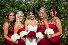 Love how the bridesmaids have ivory bouquets and bride has colored bouquet, not these colors or flowers though
