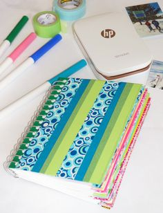 Colorful Washi Tape Mini Photo Journal | Turn an ordinary mini notebook into a colorful washi tape mini photo journal using prints from your HP Sprocket!
