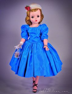 Cissy in a saphire blue taffeta 1956 No. 2012 dress with mutton sleeves, drop waist and tulle pillbox hat.