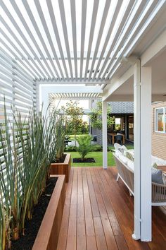 Cool inspiration for a deck on the back of your home if it faces a busy road and/or you get afternoon sun and don't like the look of the black shades.