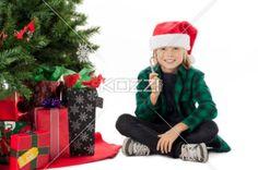 smiling boy holding christmas candy. - Portrait of a smiling boy holding christmas candy, Model: Josh Chapman