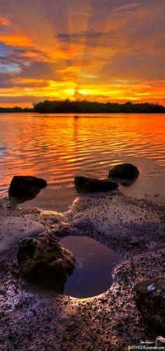 Bursting Sunset over Lake Worth Lagoon from Singer Island, Florida, USA | By Justin Kelefas