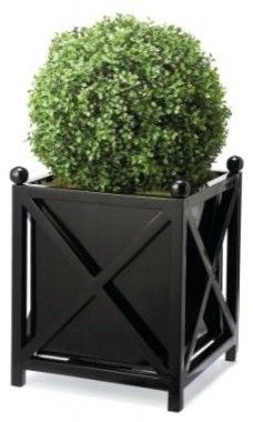 These all-weather planters are classic and can be used year-round. They would look great as a pair flanking the front door. I would add low-maintenance greenery to my porch with a simple boxwood topiary or a small spruce tree.