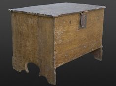 Late medieval English plank chest of small proportions. Constructed of remarkably high-quality riven oak (timber that is split along the radial plane rather than sawn), secured with wooden pins. The sides terminate in shaped Gothic tracery composed of trefoil-headed lancets flanked by outward facing buttresses. Retains original lid, lock, lock-plate, hinges, and nearly full height. …