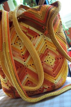 https://flic.kr/p/4r5U3A - Dawn Sparks Sunshine Hobo Bag. Love this version of Inga's Crocheted Bag - there's a pdf pattern link.