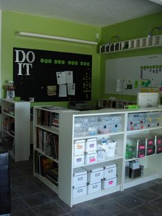 love the variety of storage options. Nice use of space by having shelving above the white board. Perhaps have 'educational collectibles' collection displayed here. Love the contrast of black and white boards. love the wood letters - on the bulletin board. I wish I could paint my classroom walls!