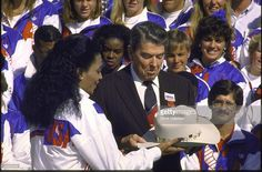 Ronald Reagan admiring cowboy hat given him by track star Florence Griffith Joyner (R) w. other members of US Olympic Flo Jo, Us Olympics, President Ronald Reagan, Sport Icon, Beautiful Black Girl, Olympic Team, African American History, Track And Field, Gymnastics