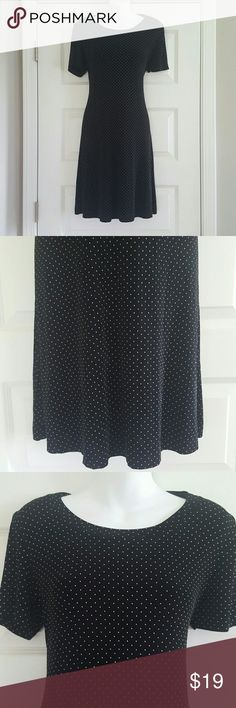 Vintage Slinky Black & White Polka Dot Dress Beautiful black and white polka dotted dress by Dress Barn.    Dress has shoulder pads but they're easy to take out!  Form fitting and flattering.    90% acetate, 10% spandex Dress Barn Dresses