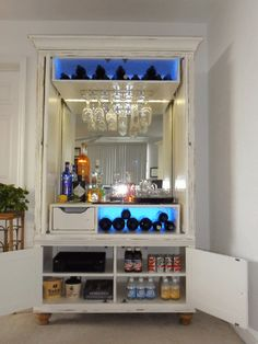 old tv armoire turned into a bar.....been searching high and low for the perfect one to do this with!