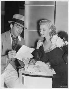 Director Mark Sandrich reads letters from fans with actress Ginger Rogers