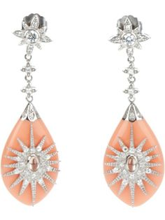 Silver earrings from Miriam Salat featuring a cubic zirconia starburst with a champagne center stone adorning a flat peach resin drop. The sterling silver post of the earring is decorated with a CZ flower and 2 more flowers link down to the resin drop. Earring measures 2 1/2 inches from top to bottom and is 3/4 inches at it's widest point.