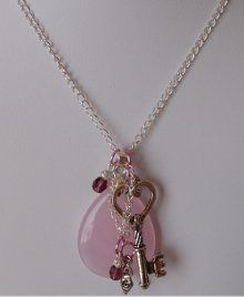 Charm cluster necklace. Interesting web site: AllFreeBeadedJewlery (learn to make fabulous beaded jewlery and more.
