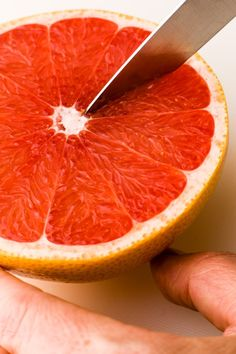 Loosen grapefruit segments with a sharp paring knife by delicately following the membranes. We generally don't bother to cut of a thin slice of the pole in order to stabilize the fruit, because that just makes it easier to pierce the skin and loose the wonderful juice.