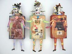 Catherine Moore's assemblage art: The Box Doll sisterhood. They incorporate her paper doll illustrations (Character Constructions) and funky little boxes. It is also a class that she teaches.
