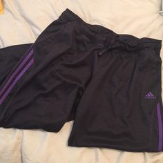 Adidas Casual Capris. Medium Charcoal gray and purple signature stripes. Two front pockets. Capri length. Elastic wait with drawstring. Medium. Worn twice. Adidas Pants Capris