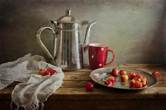 Cherries by Anna Nemoy. She does beautiful classic still life photography.
