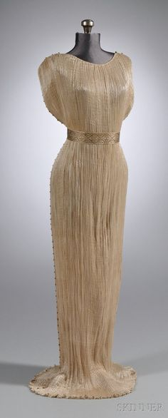 """Delphos"" Gown with Murano Glass Beadwork, c. 1910, Venice, Italy- The Delphos gown was a finely pleated silk dress first created in about 1907 by Mariano Fortuny y Madrazo (1871–1949) and made until about 1950. It was inspired by, and named after, a classical Greek statue, the Charioteer of Delphi."