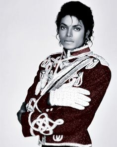 Michael Jackson in uniform equipped with glove.
