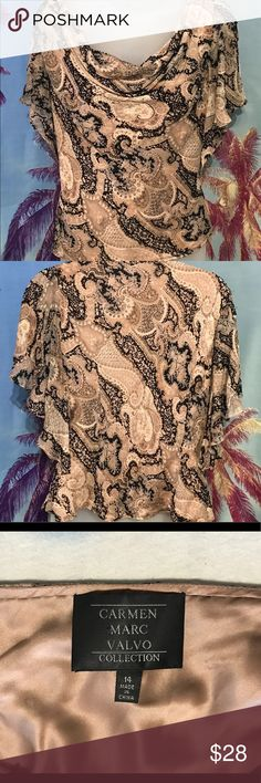 "Carmen Marc Valvo beaded top Gorgeous Carmen Marc Valvo drape front top. Tastefully beaded in a paisley inspired print sheer over 100% silk lining. Tagged a size 14, it measures 20"" across at the bust and is 21"" long. Snap straps at shoulders hold it to bra straps and small ""weight"" keeps the drape in place. All reasonable offers welcome. Carmen Marc Valvo Tops"