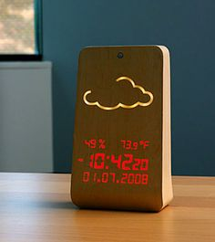 This clock does it all, and looks great doing it! Not your standard LED clock/weather station, the inert Wood Station Clock is motion activated to display glowing information pseudo-magically. Lifehacks, Weather Display, Whatsapp Tricks, Affordable Website Design, Fitness Armband, Cool Clocks, Apps, Wooden Clock, Digital Alarm Clock