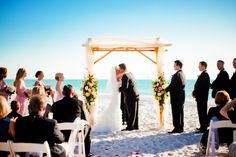 For a beach wedding you NEED an arch in order to capture the guests attention and create a focus area. Make sure your arch isn't too much; you wouldn't want to take from the ocean and beach's natural beauty. This couple's arch is perfect. Clean cut, simple, and stunning.