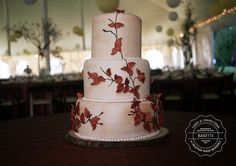Pretty Autumn Wedding Cake!  love the color of the icing and the copper leaves. could mashup with as you wish cake