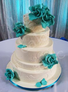 #fondant covered #weddingcake with #turquoise #sugarroses, #laceappliques and #sugarpearls by thecakeattic.com in Salisbury, NC. Delivered to The Salisbury Train Depot.