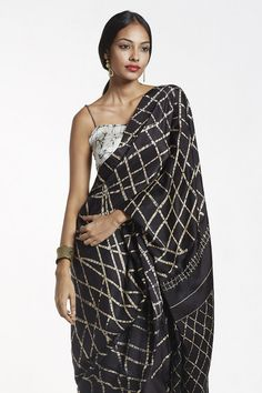 This black saree with soft metallic batik print can be worn with a simple saree jacket for a balance of modernity & femininity.