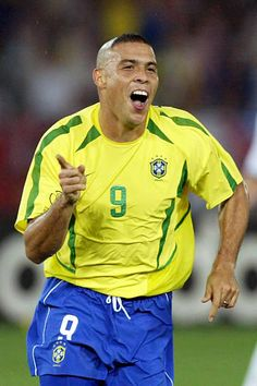 Ronaldo of Brazil celebrates scoring his team's second goal during the FIFA World Cup Korea/Japan final match between Germany and Brazil at the. Brazil Football Team, Football Is Life, World Football, Ronaldo 9, Ronaldo Football, Soccer Guys, Soccer Players, Brazilian Ronaldo, Lionel Messi Barcelona