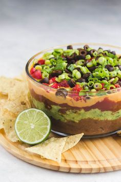 The Ultimate Vegan Seven Layer Dip is part of The Ultimate Vegan Seven Layer Dip From My Bowl - This Vegan Seven Layer Dip is made of layers of Refried Beans, Guacamole, Queso, and more making it a perfect appetizer or party treat! Vegan Apps, Vegan Foods, Vegan Snacks, Vegan Dishes, Vegan Recipes, Cooking Recipes, Vegan Mexican Recipes, Vegan Lunches, Indian Recipes